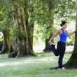 Stock Photo: Womin park stretching