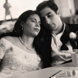 Stock Photo: Bride and groom with eyes closed at diner
