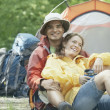 Couple embracing at their campsite - Photo