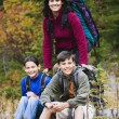 Family camping in forested area — Stock Photo #13232174