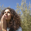 Young woman praying outdoors — Stock Photo