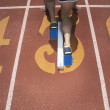 Rear view of track athlete at starting line - Foto Stock