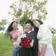 Stock Photo: Graduate mother receiving praise