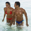 South American couple walking in water — Stock Photo #13232295