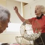 Elderly woman playing bingo — Stock Photo #13232312