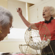 Stock Photo: Elderly womplaying bingo