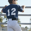 Rear view of boy watching baseball game — Stock Photo