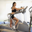 Stock Photo: Woman exercising at health club