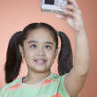 Young girl taking a picture of herself — Stock Photo