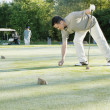 Picking up ball on putting green — Stock Photo #13232382