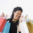 Woman holding numerous shopping bags — Stock Photo