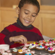 Young boy decorating cookies — Stock Photo