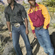 Stock Photo: Young men in cowboy outfits posing for the camera