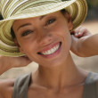 Young woman smiling in sunhat — Stok fotoğraf