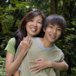 Portrait of mother and son smiling — Stock Photo