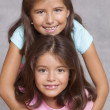Portrait of two girls smiling — Stock Photo