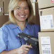 Female warehouse worker with barcode scanner — Stock Photo