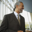 Middle-aged African businessman smiling — Stock Photo