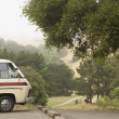 Recreational vehicle parked by country road — Stock Photo