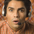 Stock Photo: Young man wearing a headset