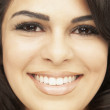 Close up of Hispanic woman smiling - Stock Photo