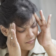 Close up of woman with headache — Stock Photo