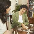 Asian mother and adult daughter playing dominoes — Stock Photo