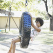Portrait of woman on tire swing — Stock Photo