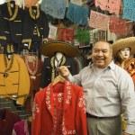 Постер, плакат: Senior Hispanic man holding a matador outfit