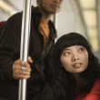 Couple on metro train — Stock Photo
