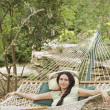 Young woman lying on hammock - Stock Photo