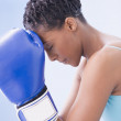 African American woman wearing boxing gloves - Photo