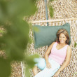 Young woman resting on hammock — Stock Photo
