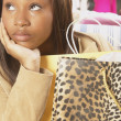 Close up of African American woman with shopping bag — Stock Photo
