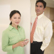 Stock Photo: Businessman and woman posing