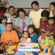 Foto Stock: Large Hispanic family celebrating birthday