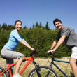 Stock Photo: Couple on bicycles in rural area
