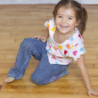 Portrait of young girl kneeling on floor — Stock Photo