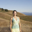 Woman standing in hilly terrain - Stok fotoğraf