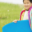 Portrait of boy with body board - Photo