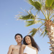 Foto Stock: Couple in bathing suits smiling