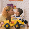 Profile of mother kissing son — Stock Photo