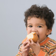 Portrait of young boy eating pear — Stock Photo #13232906