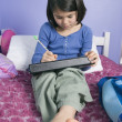 Asian girl doing homework — Stock fotografie