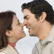 Hispanic couple kissing - Stock Photo