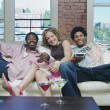 Portrait of group sitting on couch laughing — Stock Photo
