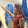 African teenage girl in clothing store — Stock Photo