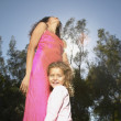 Stock Photo: Mother and daughter dancing outdoors