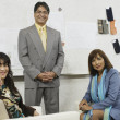 Businesspeople smiling for the camera — Stock Photo