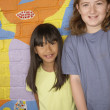 Multi-ethnic children in front of mural — Stock Photo